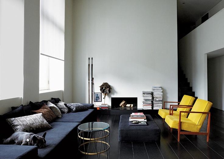 Black gloss floors | yellow chairs
