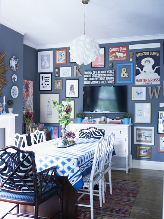 Bold art wall as seen in Home for Now by Joanna Thornhill